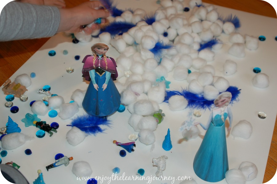 Frozen Sensory Bin Playing 2