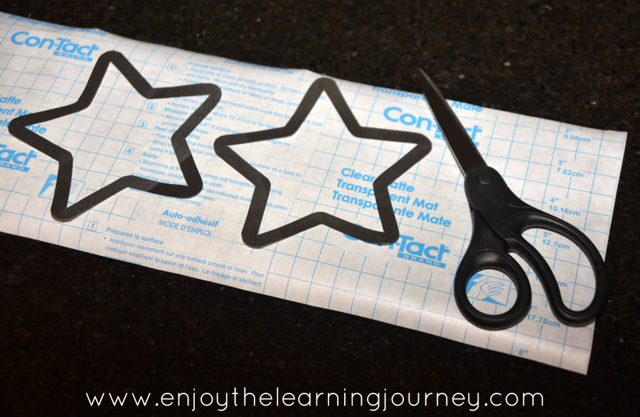 Stars with black outline on Con-tact paper