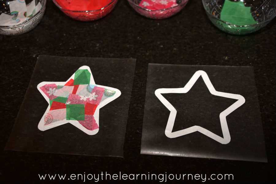 Two parts of Christmas star paper craft on table